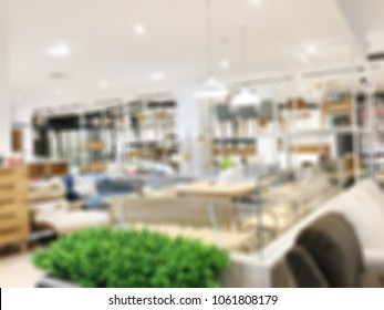 Abstract blurred photo of material store in shopping mall which have ceramic tile and wood tile, laminate , tile, vinyl, showroom materials concept