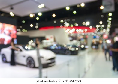 Abstract blurred photo of motor show, car show room