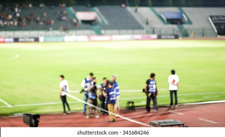 Abstract blurred photo of sport reporter in football stadium