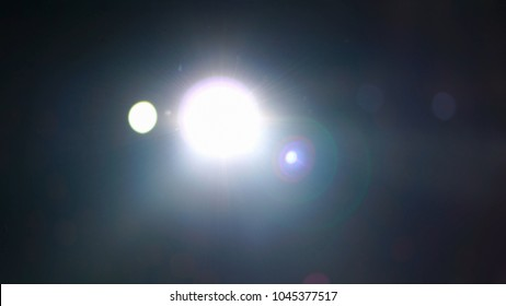 Abstract blurred photo of spotlight with flare in conference hall, seminar and party environment concept