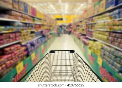 Abstract blurred photo of store with trolley in department store.