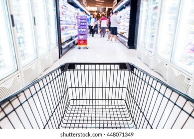 Abstract blurred photo of store with trolley in department store bokeh background