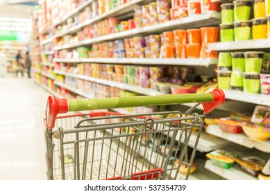 Abstract blurred photo of store with trolley in department store