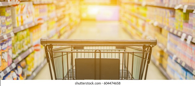 Abstract blurred photo of trolley in department store bokeh background,Shopping cart in supermarket ,vintage color,for banner