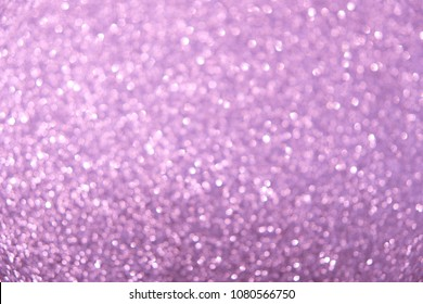 abstract blurred pink-lilac background with light spots. art images. blurred festive bright background for your design. soft selective focus.