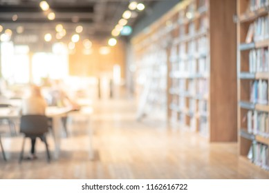 Abstract blurred public library interior space. blurry room with bookshelves by defocused effect. use for background or backdrop in business or education concepts