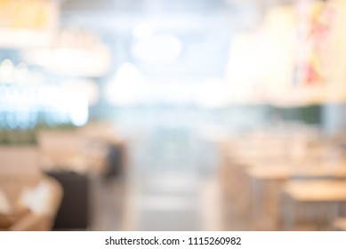 Abstract blurred restaurant background. Blurry cafe or coffee shop with dining tables, chairs and other decorations. Blur backdrop for design element. Food and beverage concept.