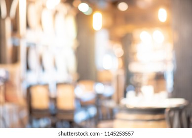 Abstract blurred restaurant background. Blurry cafe or coffee shop with table, chair and other decoration. Blur backdrop for design element. Food and beverage concept.