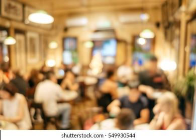 Abstract blurred restaurant interior background, with customers. Blurred background. Retro restaurant interior background.