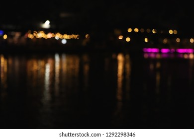 Abstract blurred of river and night light for background.