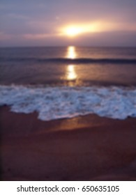 Abstract blurred romantic tropical beach with wave, sea, sun and sky