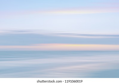 Abstract blurred sea landscape and cloudy sky background in light tonality with copy space