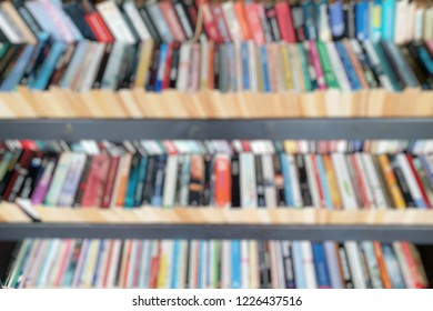 Abstract blurred shelf book for background.