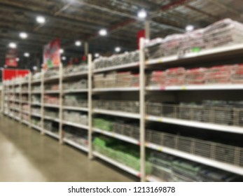 Abstract blurred of the shelves with products in wholesale superstore or department store, or shopping mall.