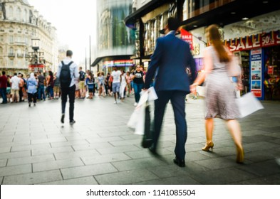 Abstract blurred shoppers on busy shopping high street