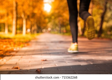 abstract blurred  silhouette,sport; runner female, background;In autumn part with fall trees copy space