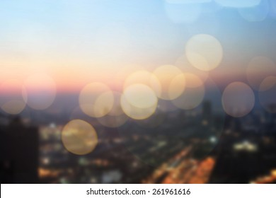abstract blurred sky night city building background with bokeh light effect.