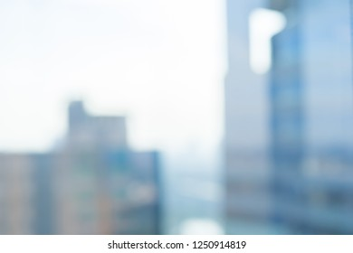 abstract blurred skyscraper office building view from high window for financial background