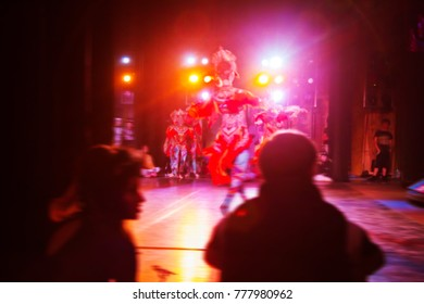 an abstract blurred, soft focal picture with long exposure is an illustration of the ballet's performance on modern stage. Bright theatrical abstract background with creative artists in motion blur