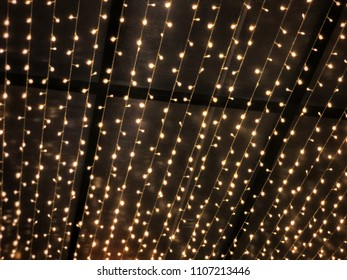 Abstract blurred of sparkle circle golden bulbs light background