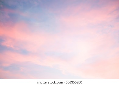Abstract blurred sunset sky and clouds background with glowing flare light.