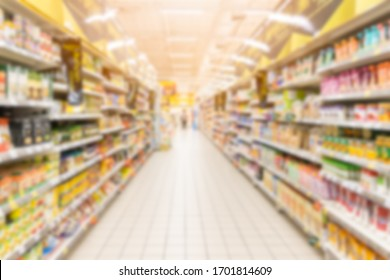 Abstract blurred supermarket aisle with colorful shelves in shopping mall interior for background, Blurred background.