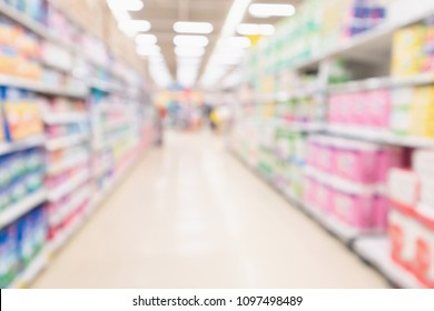 Abstract blurred supermarket aisle and shelves with various toilet tissue paper display