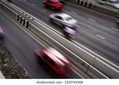 Abstract blurred traffic on Tollway Road in the city