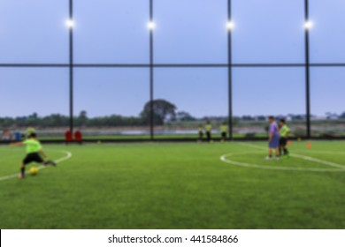 Abstract blurred training soccer (football) match with shallow depth of field.