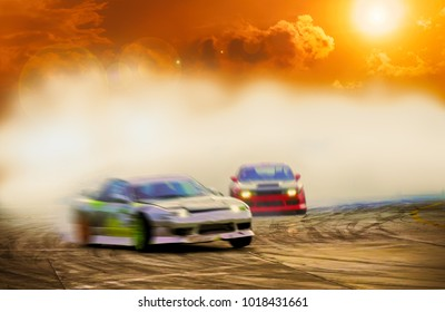 Abstract blurred two drift cars battle with smoke from burned tire