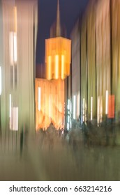 Abstract blurred view of Warsaw old city street and royal castle tower