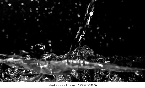 abstract blurred water splash texture on dark background for freshness concept