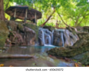 Abstract blurred waterside pavilion with waterfall.