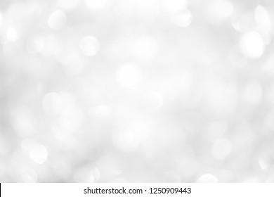 abstract blurred of white glittering shine bulb lights in panoramic horizontal background concept.