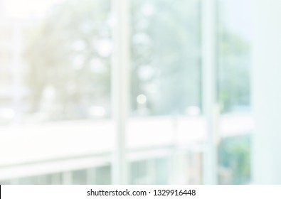 abstract blurred window in living room with garden view and sunlight for background concept