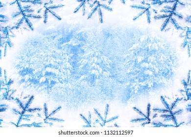 Abstract blurred winter background. Trees in the snow.