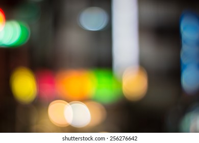 Abstract Blurry Background of A Street in Kaohsiung, With Colorful Billboards of Prismatic Colors.
