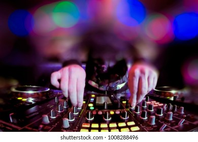 Abstract, blurry, bokeh background, image for the background. Dj playing disco house progressive electro music at the concert