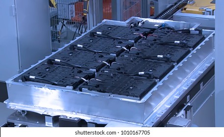 Abstract, blurry, bokeh background, image for the background. Manufacture of batteries for hybrid cars