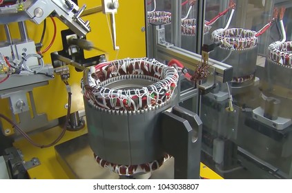 Abstract, blurry, bokeh background, image for the background. Stator with a copper coils, electric magnetic device use for eletric motor production