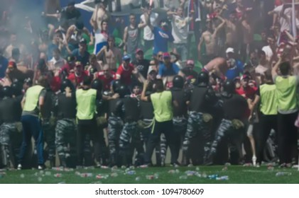 Abstract, blurry, bokeh background, image for the background. Clutter football fans clash with police