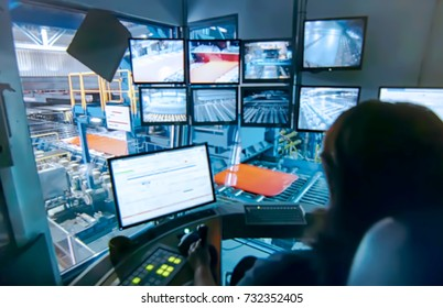 Abstract, blurry, bokeh background,  image for the background. Central control panel of. The engineering personnel watch in monitors work of the equipment