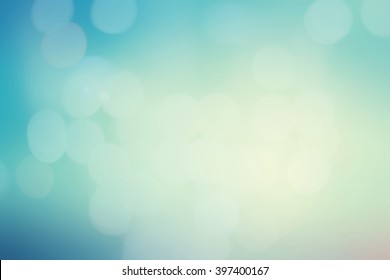 abstract blurry bokeh pastel tone colorful with bulbs blue gradient background with lens flare light image.vintage tone color filter.
