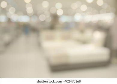 Abstract blurry bright bed selling on large shopping mall hall