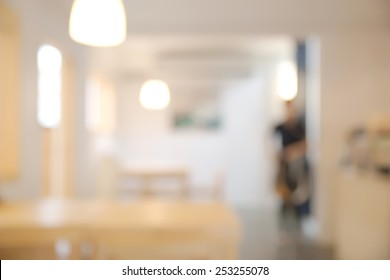 Abstract blurry bright restaurant interior with unrecognizable waitress