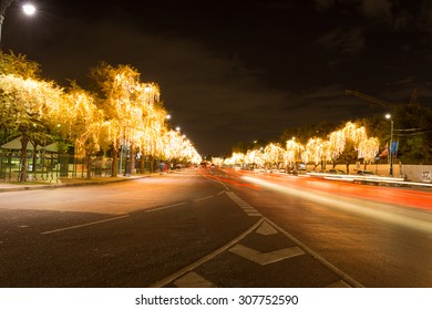 Abstract blurry car motion on road and tree lighting bokeh