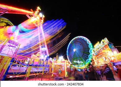 Abstract blurry light background with long exposure picture of a carrusel rotating during the christmas fair in Alicante, Spain