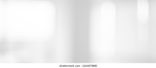 abstract blurry loft cozy interior office workplace background with light window effect for banner , ads design