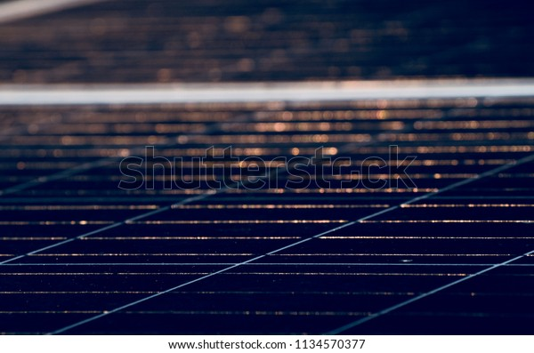 Abstract blurry sunlights reflection on a solar panel surface unique photo
