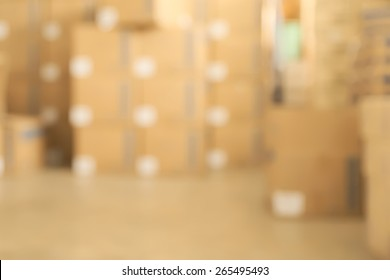 Abstract blurry warehouse storing a lot of stack of large box background